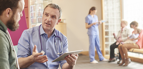 A doctor talking with a patient