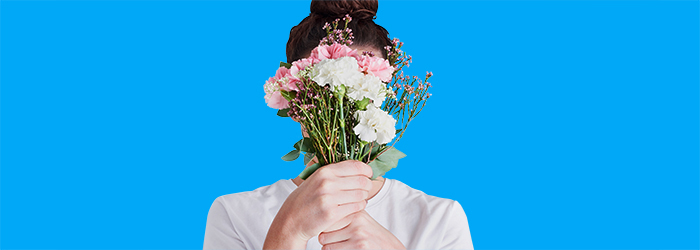 A person holding flowers.